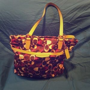Coach purple and pink tote purse.